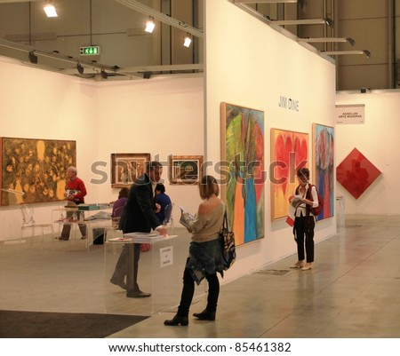 MILAN - APRIL 08: Looking at paintings and sculpture galleries during MiArt, international exhibition of modern and contemporary art on April 08, 2011 in Milan, Italy