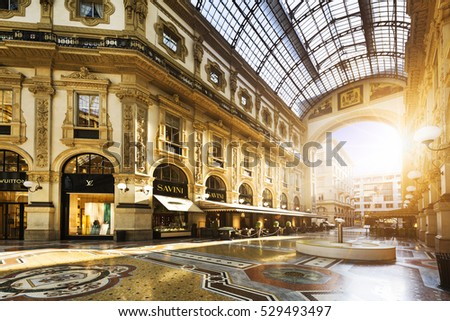 MILAN, ITALY - AUGUST 29, 2015: Luxury Store in Galleria Vittorio Emanuele II shopping mall in Milan, with tasted Italian restaurants