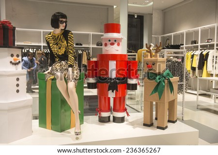 MILAN, ITALY-DECEMBER 02, 2014: santa claus and reindeer decorations with a fashion mannequin at the Moschino boutique window store in the downtown fashion district, in Milan.