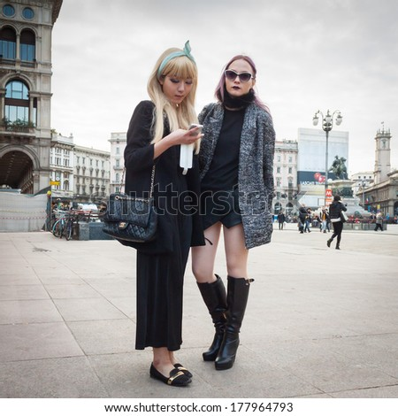 MILAN, ITALY - FEBRUARY 20: People gather outside the fashion shows buildings for Milan Women's Fashion Week on FEBRUARY 20, 2014 in Milan.