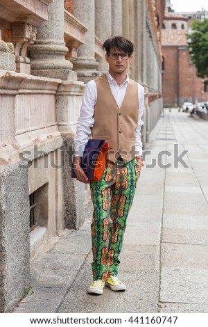 MILAN, ITALY - JUNE 19: Fashionable man poses outside Missoni fashion show building during Milan Men's Fashion Week on JUNE 19, 2016 in Milan.