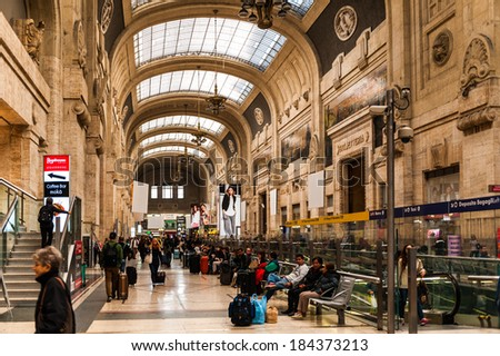 MILAN, ITALY - MAR 29, 2014: Arrival hall of the Milano Centrale - The main railway stration of Milan, Italy. It was opened on July 1, 1931.