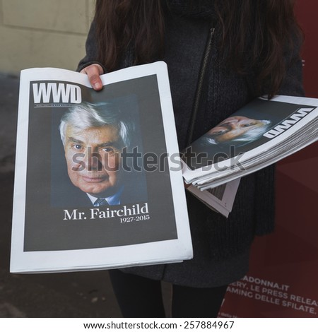 MILAN, ITALY - MARCH 2: Detail of a girl distributing WWD magazine outside Alberto Zambelli fashion show building for Milan Women's Fashion Week on MARCH 2, 2015  in Milan.