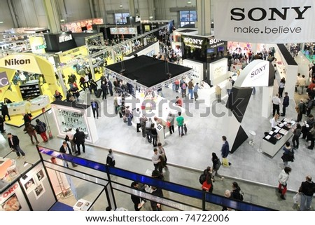 MILAN, ITALY - MARCH 26: Panoramic view of people looking for cameras, lenses and accessories at PHOTOSHOW, International Photo and Digital Imaging Exhibition on March 26, 2011 in Milan, Italy.