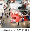 MILAN, ITALY - OCTOBER 08: Panoramic view of people visiting Sfortec 2010, international exhibition of machines, robots, automation and auxiliary technologies October 08, 2010 in Milan, Italy. - stock photo
