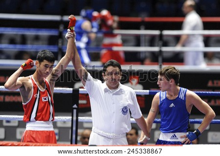 MILAN, ITALY-SEPTEMBER 03, 2009: referee proclaims winner of the match an amateur boxer during the amateur world boxing championship, in Milan.