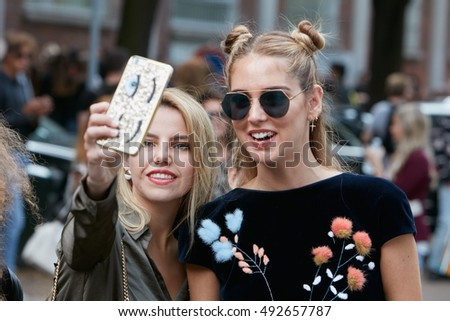 MILAN - SEPTEMBER 22: Chiara Ferragni selfie with a fan after Fendi fashion show, Milan Fashion Week street style on September 22, 2016 in Milan.