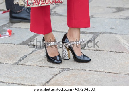 MILAN - SEPTEMBER 21: Women poses for photographers with python shoes and red pants before Gucci fashion show, Milan Fashion Week Day 1 street style on September, 2016 in Milan.
