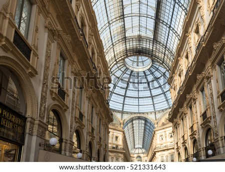 Milano Italy 23 November 2016: The Vittorio Emanuele II Gallery in Milan is a shopping arcade, in the form of covered pedestrian street connects Piazza Duomo to Piazza della Scala