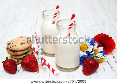 Milk and cookies on a old wooden background