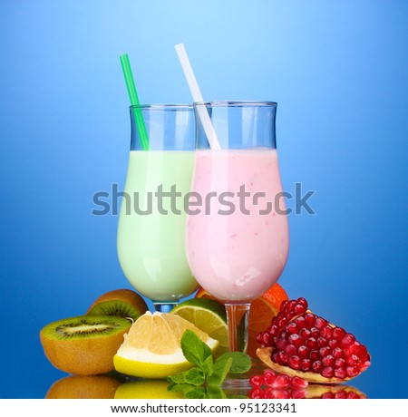 Milk shakes with fruits on blue background