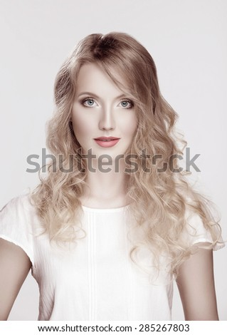 milk skin Portrait of young blond girl with makeup and retouch