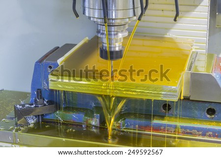 Milling machine CNC drill stainless steel on bench vise with oil coolant