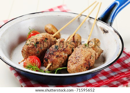 Minced meat kebabs and pan roasted mushrooms