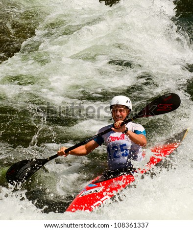 MINDEN, ONTARIO - JULY 21: An unidentified contestant competes at Ontario Summer Race 2012 on July 21, 2012 at Gull River in Minden, Ontario, Canada.