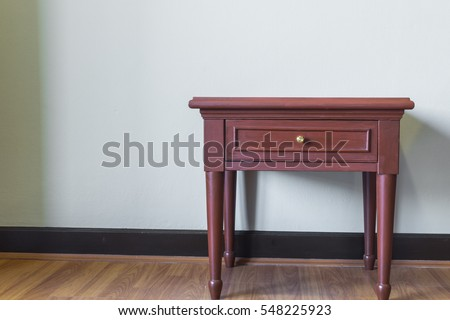 Mini wood desk with white wall background