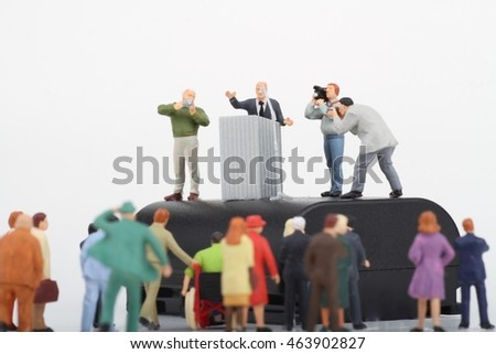miniature figurine of a politician speaking to the crowd during an election
