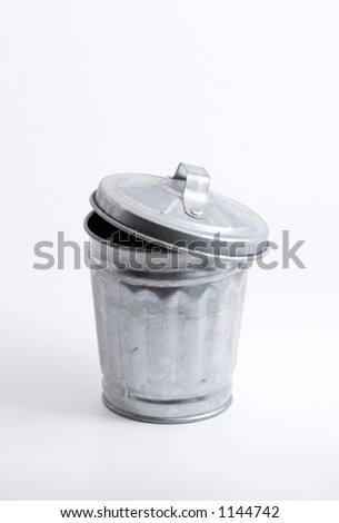 Miniature trash can over white, clipping path