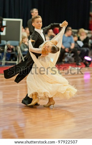 MINSK-BELARUS, MARCH 4: an Unidentified teenage Dance Couple performs Junior-2 Standard  Program on The Republic of Belarus WDSF Championship, 2 Stage, on March 4, 2012 in Minsk, Republic of Belarus