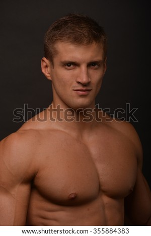 Miscled male model in studio