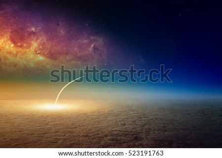Missile launch, aerial view of space shuttle taking off. Elements of this image furnished by NASA