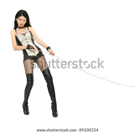 Mistress is holding a chain  isolated on white background