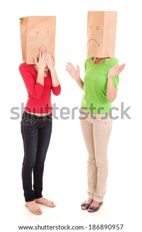 misunderstanding, two girls with paper heads, white background