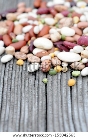 mix of beans on grunge background