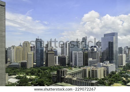Mix of old and modern urban buildings in Makati City, Manila, Philippines