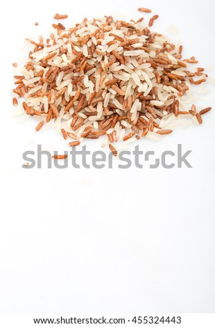 Mix raw wild brown rice and white rice over white background
