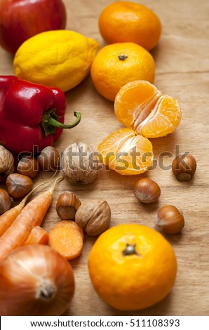 mixed fruit and vegetables on a wooden table