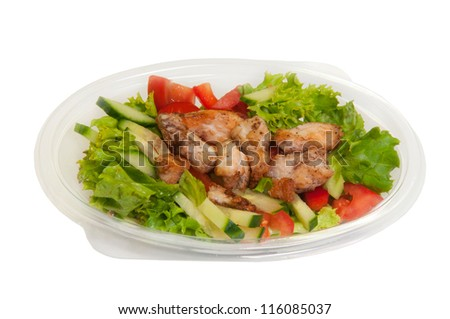 Mixed salad in a box made of chicken, lettuce and mixed vegetables.