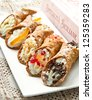 mixed Sicilian cannoli - stock photo