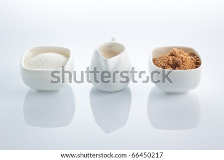 Mixture of brown and white sugar with milk for coffee.