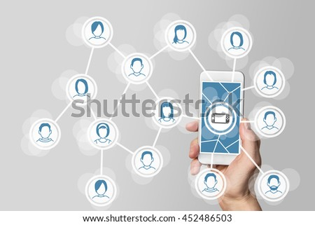 Mobile and social gaming concept with hand holding smartphone connected to network