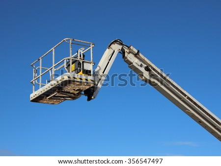 Mobile Industrial Crane Lift Basket Isolated on Blue Sky Background