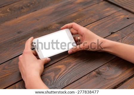 Mobile phone in the hands of a girl with a blank screen