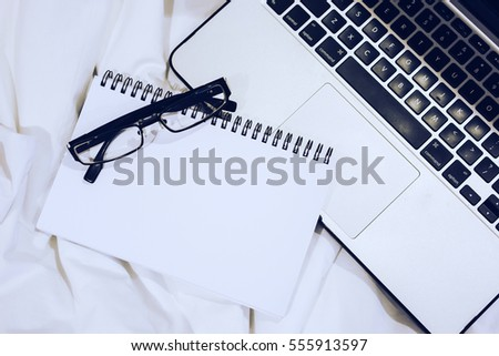 Mockup Copy space Notebook Laptop Coffee Spectacle On Bed Concept