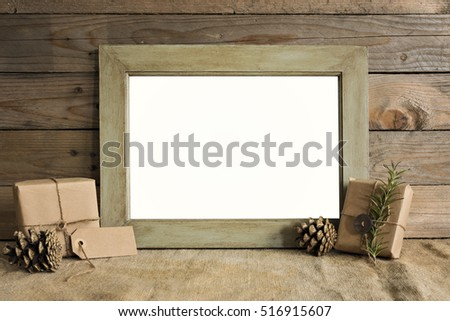 Mockup frame scene with christmas gifts and pine cones.