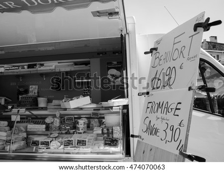 MODANE, FRANCE - AUGUST 11, 2016: Beaufort cheese and other typical cheeses for sale at farmers market at Savoie region.
