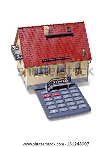 Model house and calculator on white background