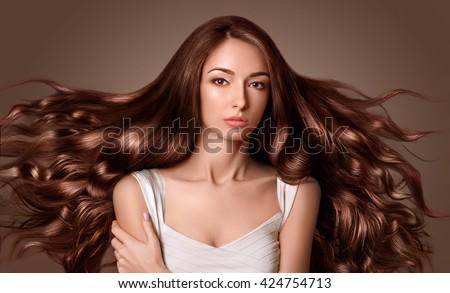 fashion model girl portrait long blowing stock photo