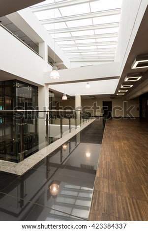 Modern academic interior in black and white with wood flooring
