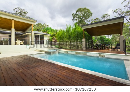 Modern backyard with entertaining area and pool in stylish Australian home
