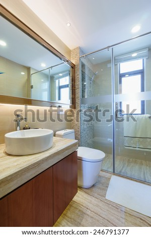 modern bathroom with mirror,cabinet,sink and toilet