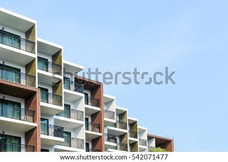Modern beautiful luxury hotel resort building and blue sky in Pattaya city, Thailand