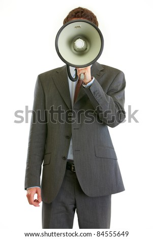 Modern businessman holding megaphone in front of face isolated on white
