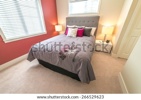 Modern comfortable and elegant luxury master bedroom with red color wall. Interior design.