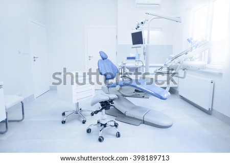 Dental Chair And Other Accessories Used By Dentists In Blue, Medic