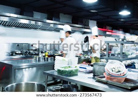 Busy Restaurant Kitchen motion chefs restaurant kitchen stock photo 154790378 - shutterstock